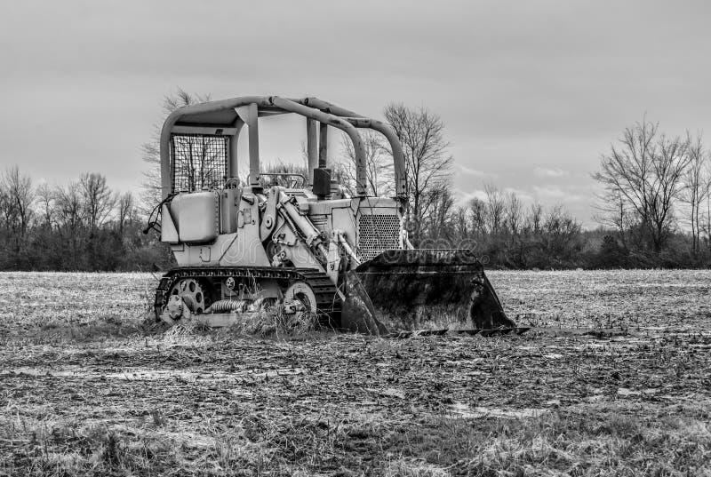 Old bulldozer. Black and white in field stock photo