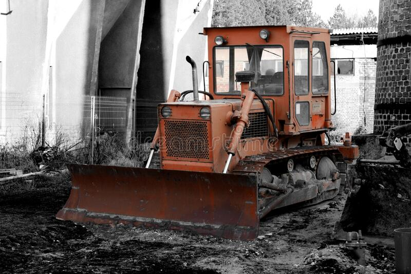 Old bulldozer. Abandoned on a construction site stock photography