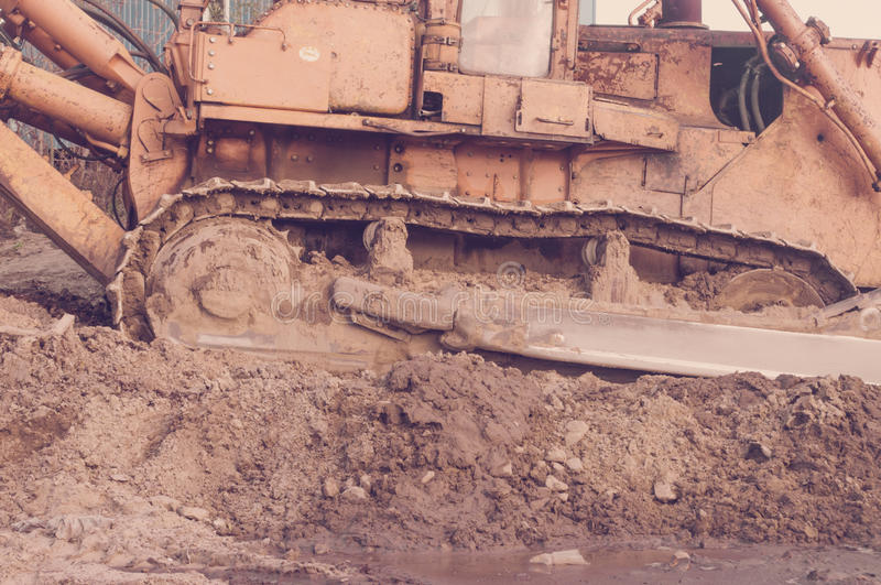 Old bulldozer track. In mud and sand stock images