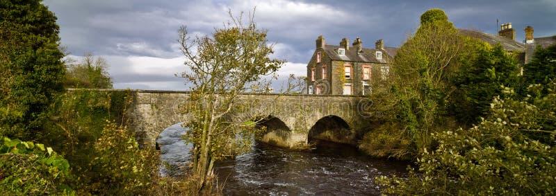 Old Bushmills village, bridge and river, Northern Ireland. Autumn royalty free stock photo