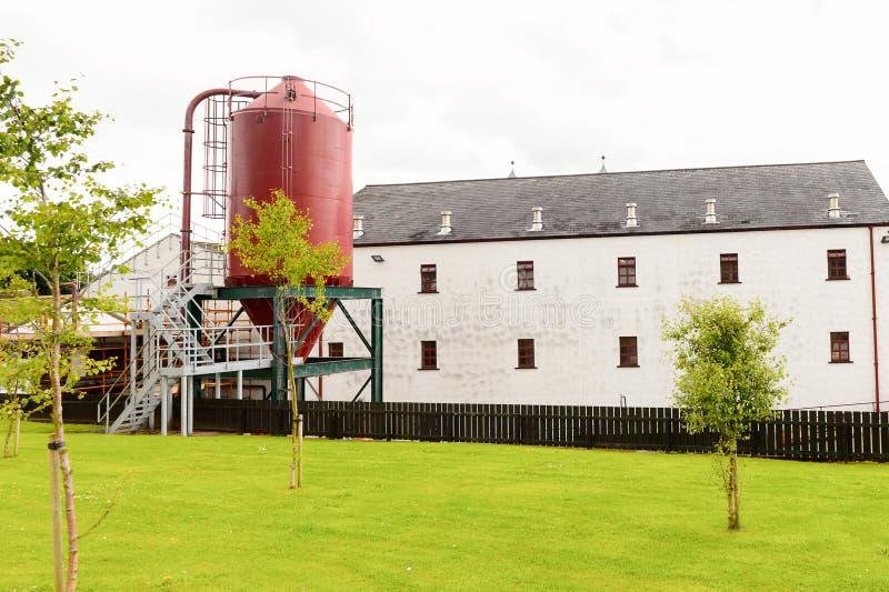 Old Bushmills Whiskey Distillery. BUSHMILLS, NI - JULY 15, 2016: Old Bushmills Whiskey Distillery. It is a popular tourist attraction stock image