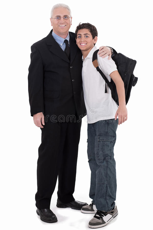 Old business man embraces a teenager. On isolated background stock photos