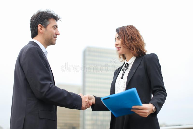 old IT business partners man with smartphone and woman meet stock images