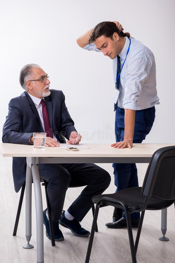 Old businessman meeting with advocate in pre-trial detention. Old businessman meeting with advocate in pretrial detention royalty free stock image
