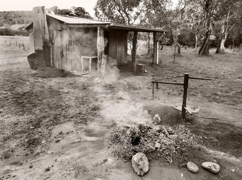 Old cabin black and white Australia. Little cottage in Australia with fireplace stock photo