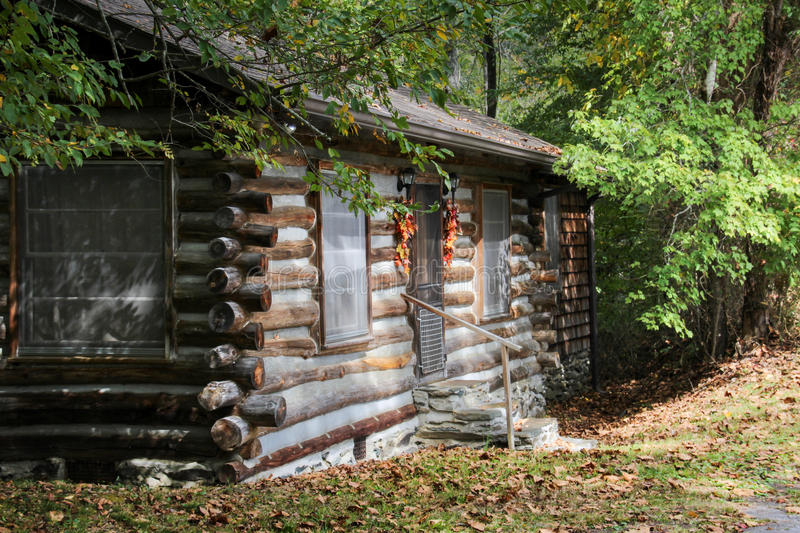 Old cabin in fall royalty free stock photography
