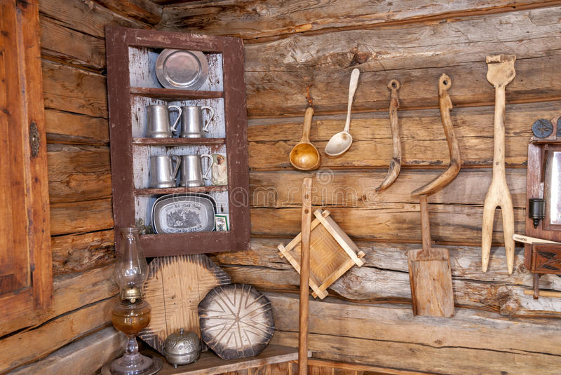 Old cabin with home made tools on the wall royalty free stock photo