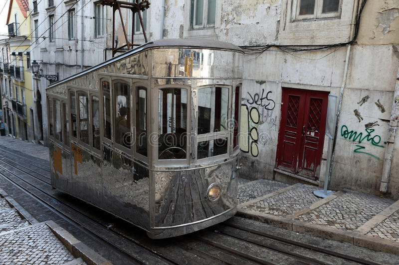 Old cable car in Lisbon, Portugal stock photos