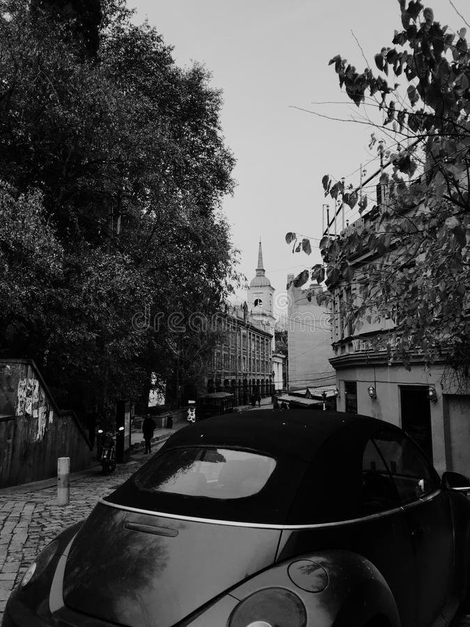 Old cabriolet on the street of tbilisi. Tbilisi, Georgia -december, 2018. Backyard in old town. Traditional georgian patio and old cabriolet car stock image