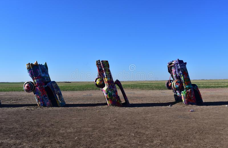 Old Cadillacs Spray Painted in Amarillo Texas. Amarillo Texas' Cadillac Ranch with spray painted cadillacs royalty free stock photo