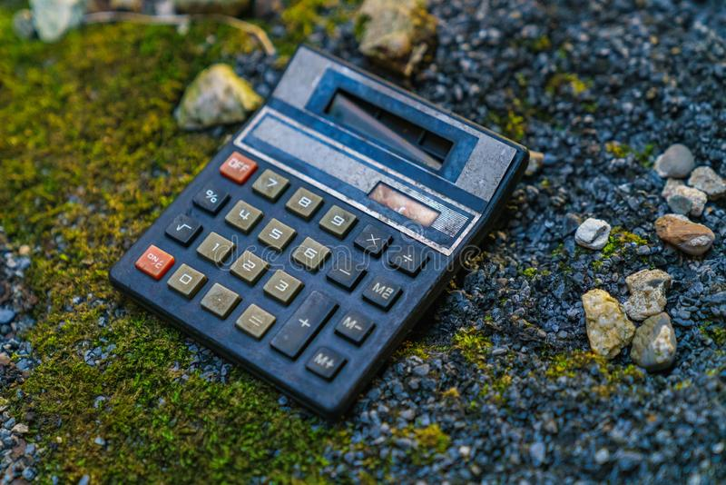 An old calculator. On a dirty floor royalty free stock photo