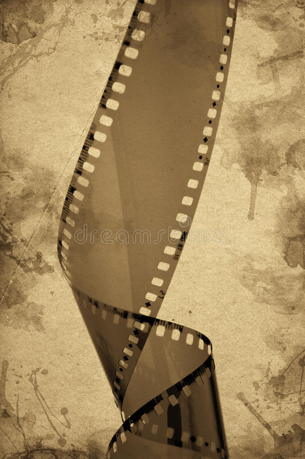 Old camera film strip. Overexposed old camera film strip over a grunge background stock photos
