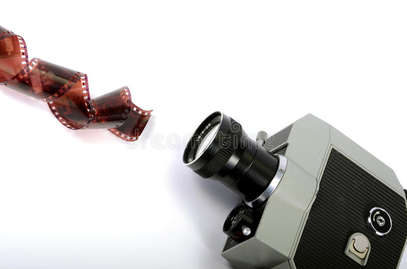 Old camera and film strip. Isolated , movie industry concept royalty free stock images