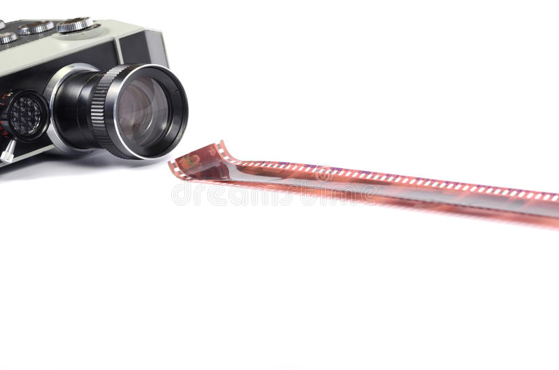 Old camera and film strip isolated. Old camera and film strip , movie production concept stock image