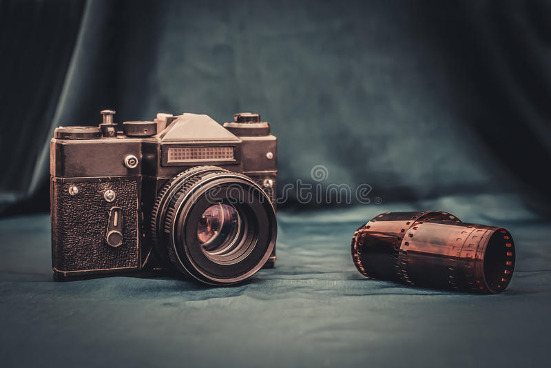 Old camera and film are on the table stock images