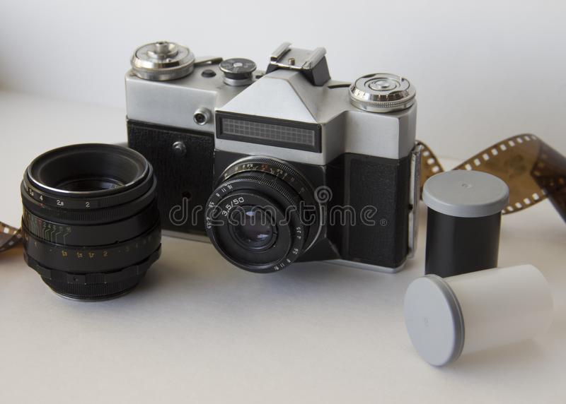 Old camera and film on white background stock photos