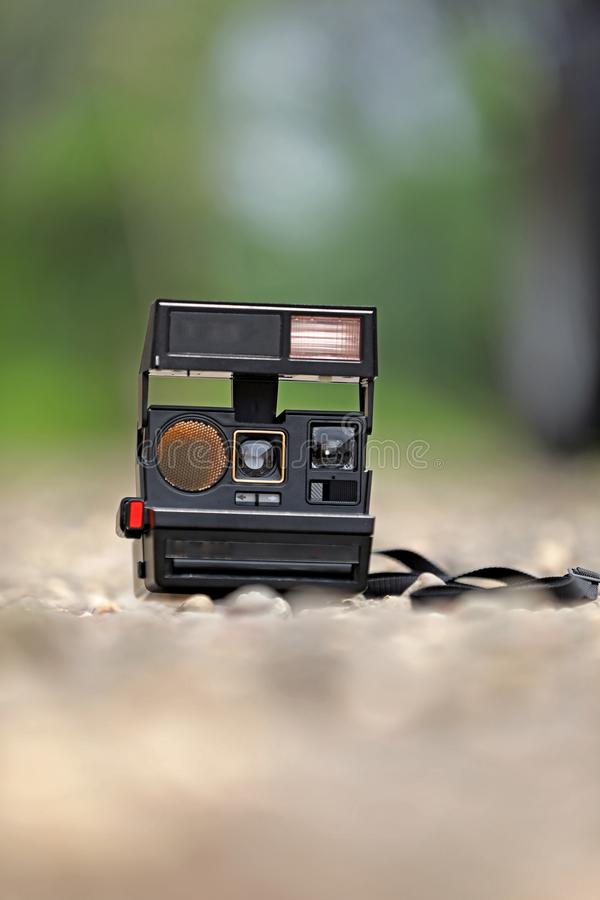 Old camera on ground royalty free stock images