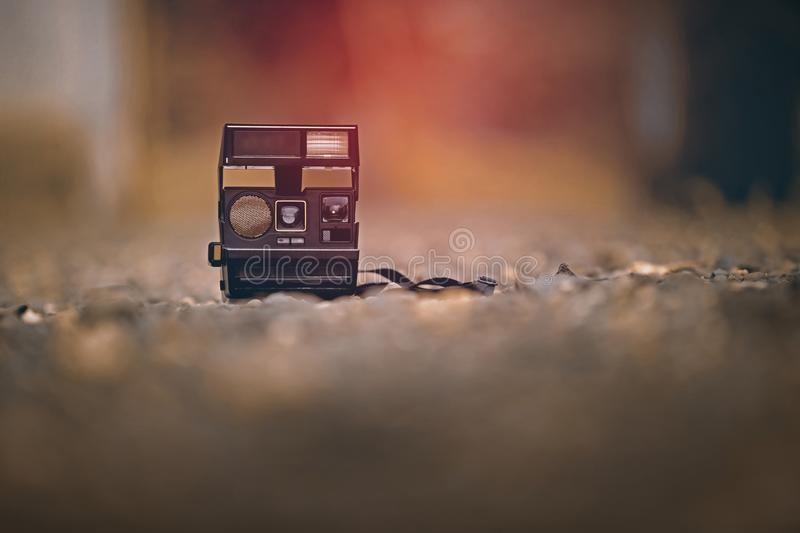 Old camera on ground royalty free stock image