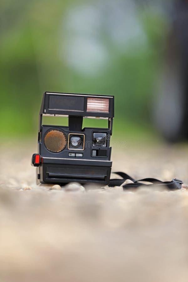 Old camera on ground stock photos