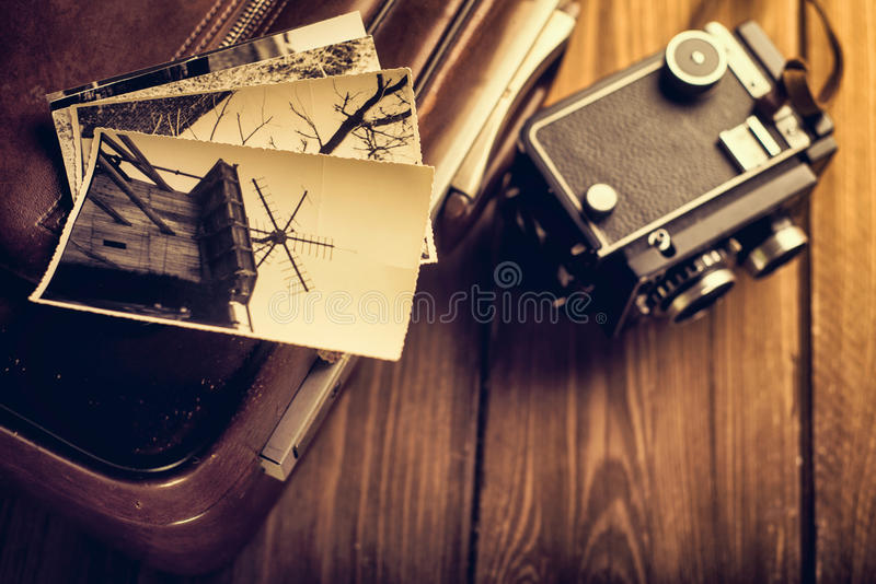 Old camera and old photos are on the case. Retouching in retro s royalty free stock photography