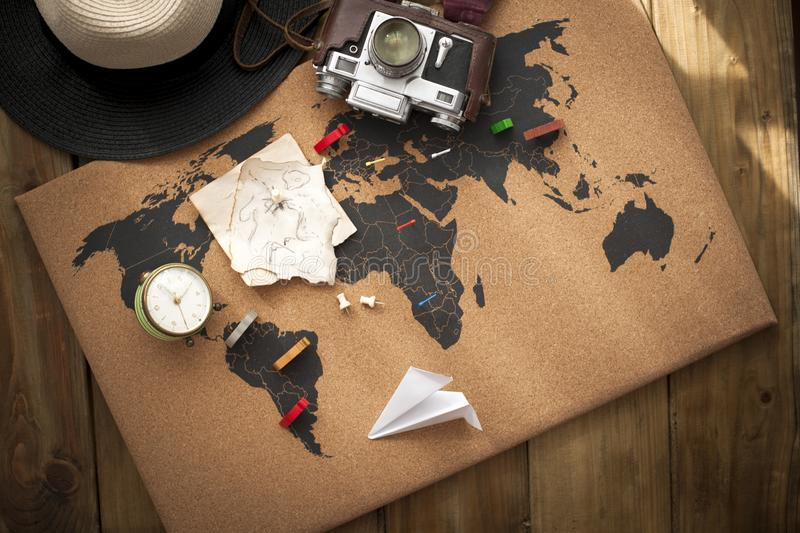 Old camera and route plan on the map, vintage photo. Travel and holidays. Copy space.  stock photography