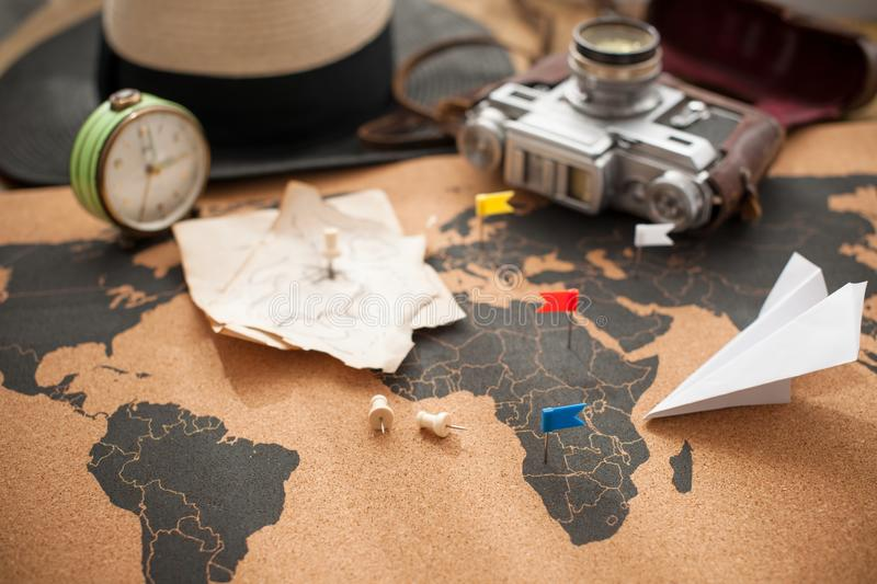 Old camera and route plan on the map, vintage photo. Travel and holidays. Copy space royalty free stock photo