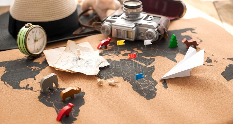 Old camera and route plan on the map, vintage photo. Travel and holidays. Copy space stock image