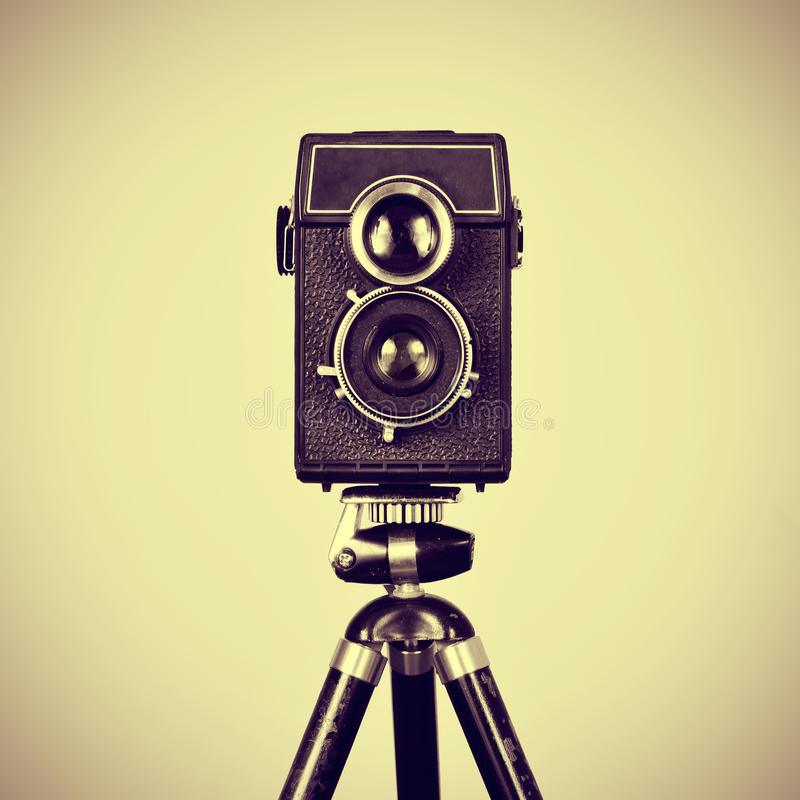 Download Old camera in a tripod stock photo. Image of beige, film - 38329422