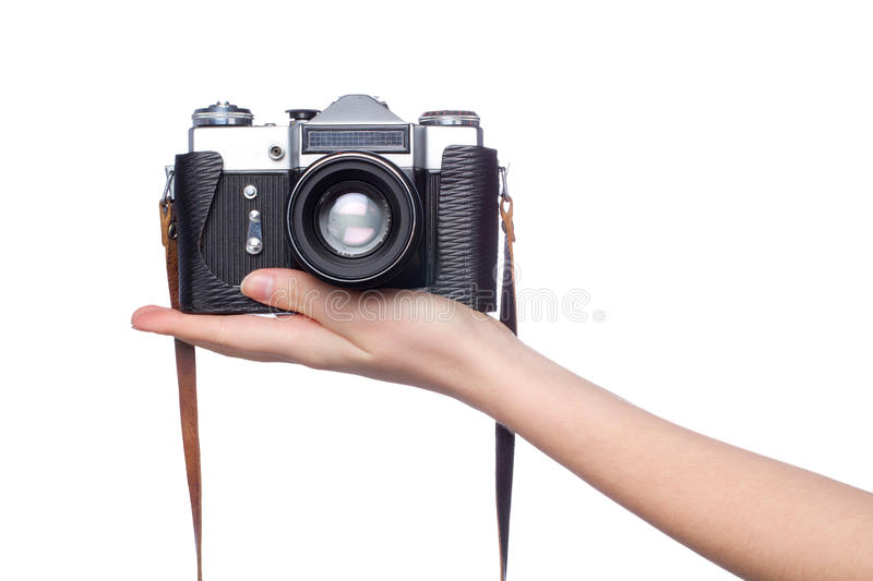 Old camera on woman hand over white. Background stock images