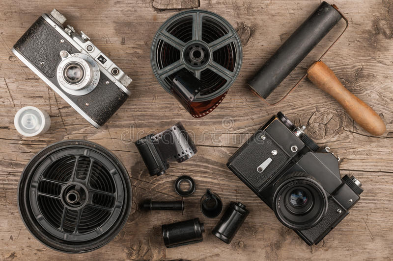 Old cameras, developing tank, tapes, film and roller for photos royalty free stock image