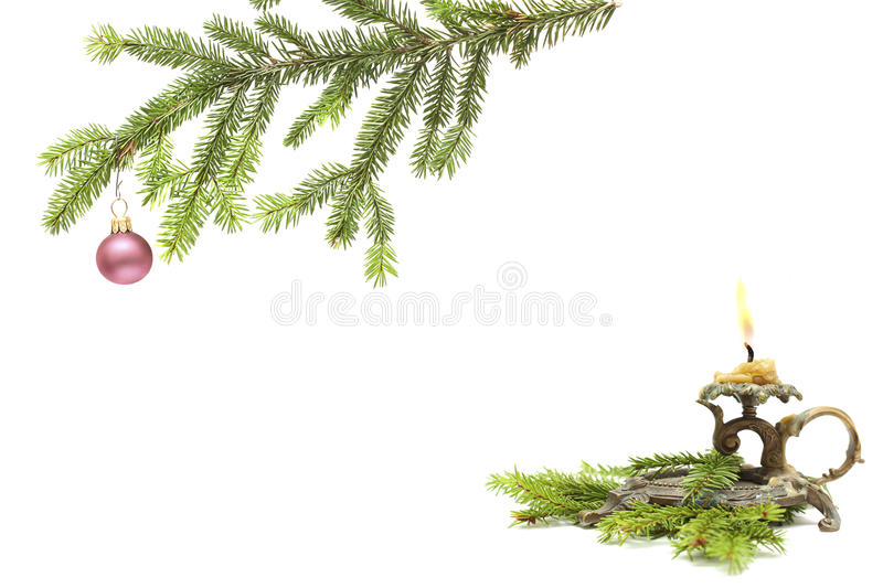 Old candlestick and christmas fir royalty free stock photography