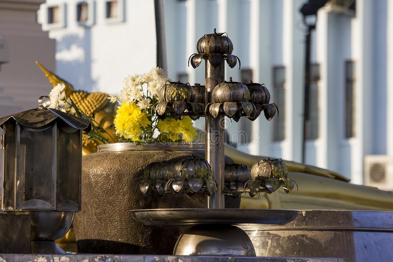Old candlestick made of stainless steel. Old candlestick made from stainless steel plate. And stain the oil stock photo