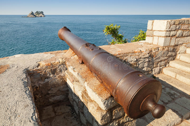 Old cannon in coastal fortress. Montenegro. Old cannon in coastal Venetian fortress Castello. Petrovac, Montenegro stock image