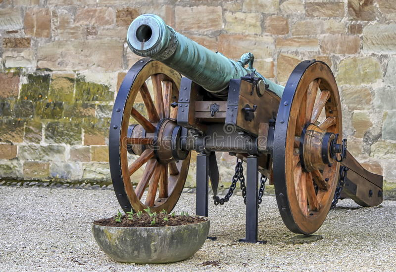 Old cannon, Morges, Switzerland. Old cannon next to a wall of the castle, Morges, Switzerland stock photography