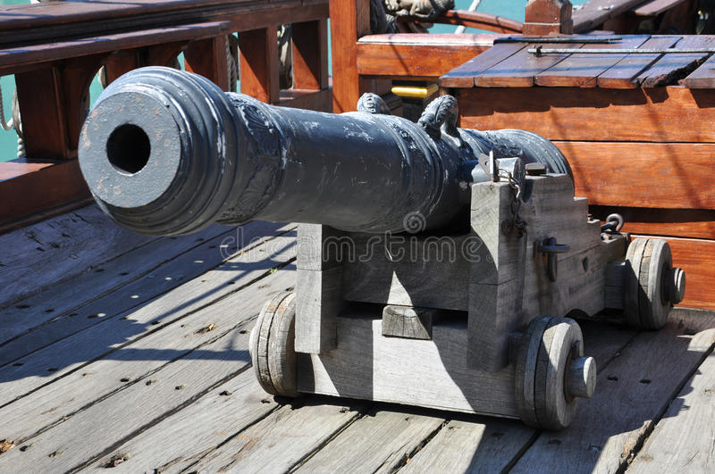 Old cannon on the ship. Old cannon on the pirate ship royalty free stock photo