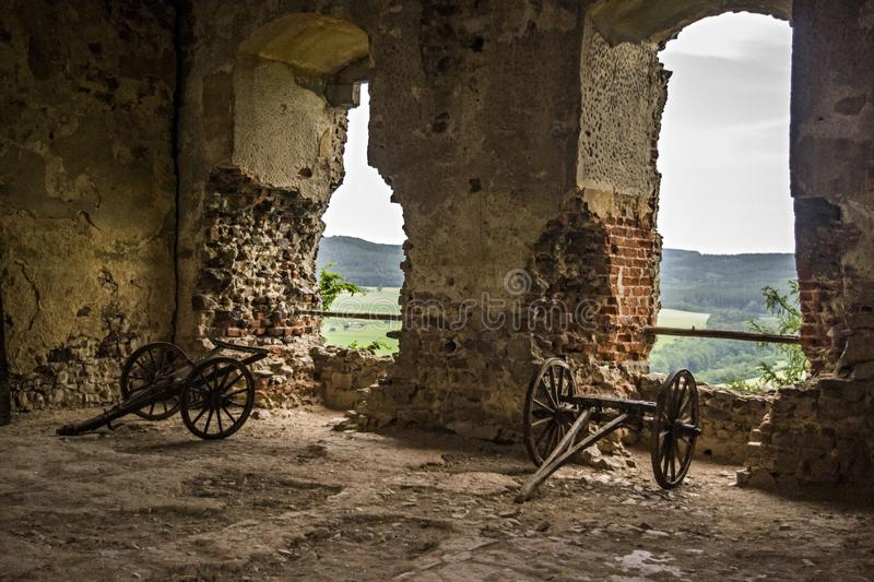 Old medieval cannons. Old cannons in the ruin of a castle pointing from the windows royalty free stock photo