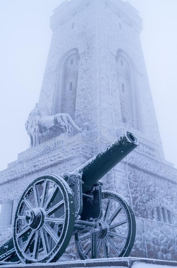 Old cannons.  Winter fog, lots of snow, old cannons covered with snow stock photo