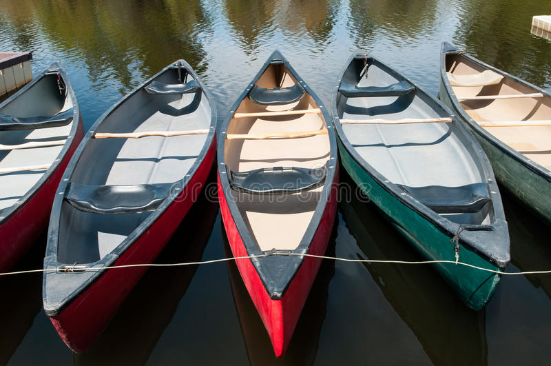 Old Canoes. Tethered at a dock royalty free stock photography
