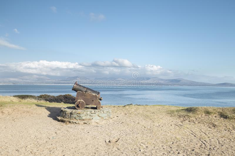Old Canon on the Tidal Isle of Ynys Llandwyn in North Wales stock photo