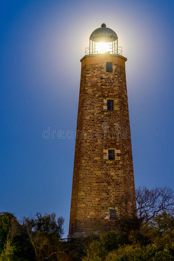 Old Cape Henry Lighthouse with moon. Image of the old Cape Henry Lighthouse located at the mouth of the Chesapeake Bay situated on Fort Story in beautiful royalty free stock photo