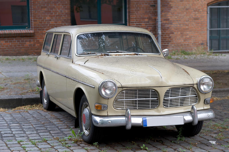 Old car. In front of building stock image