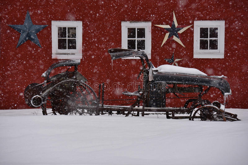 Old Car Against Red Barn in Winter royalty free stock photography