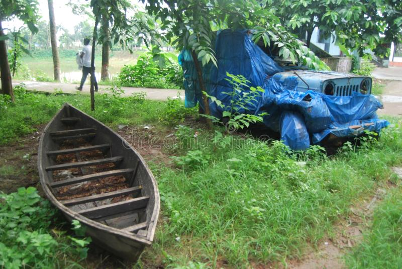 Old car of bangladesh.View of the old car and boat. Bangladesh has a few large car plants which assemble passenger cars from Mitsubishi and Proton, as well as royalty free stock photo