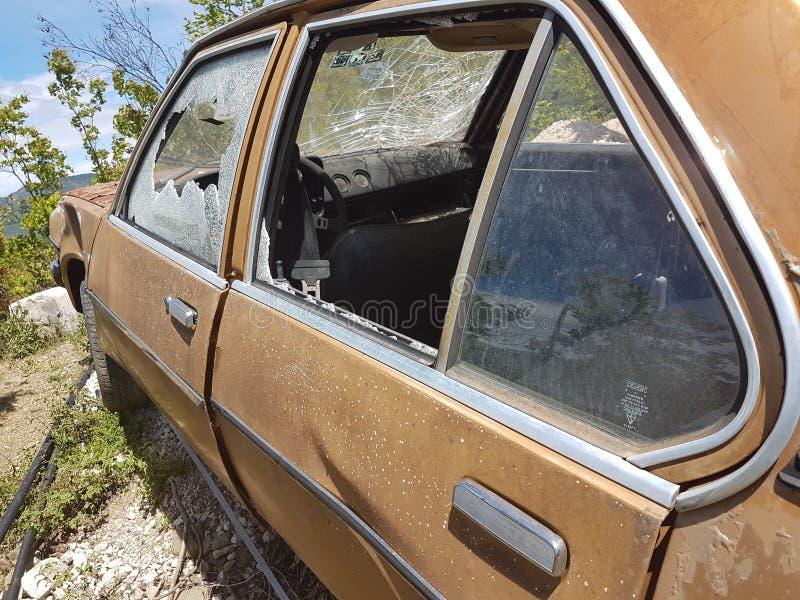 Old car broken glass steeing wheel royalty free stock image