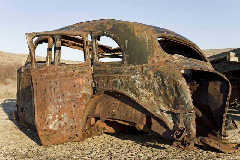 Old car carcass with bullet holes