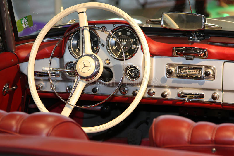 Old car cockpit. The motor show Epoq'Auto in Eurexpo Halls commemorates 60 years of Mercedes 300SL, in Lyon, on November, 10, 2012 stock photos
