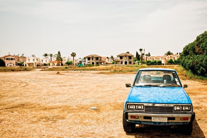 old car in desolate landscape