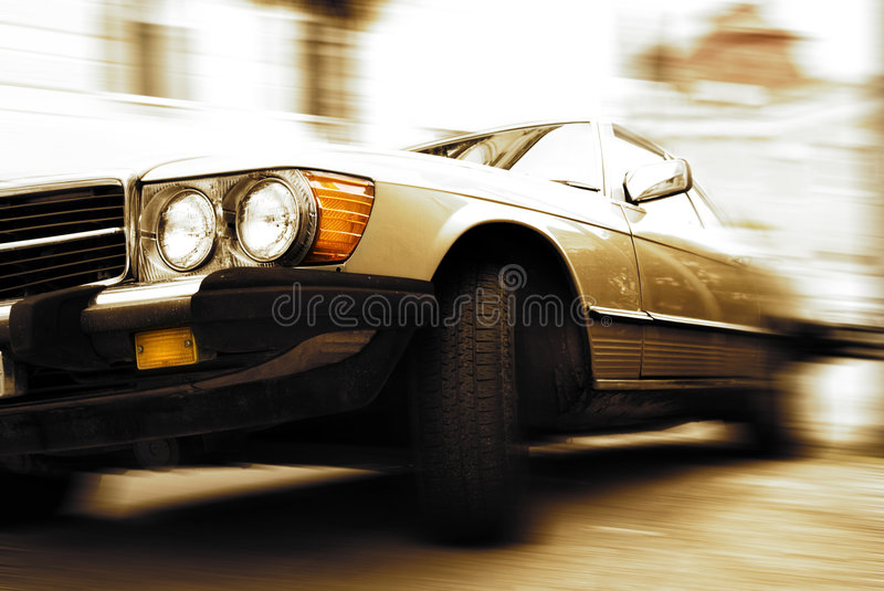 Old car driving fast. Picture of an Old car driving fast royalty free stock photo