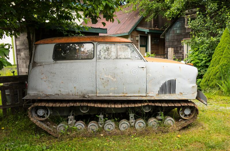An old car mounted on tracks for winter mobility in alaska royalty free stock photography