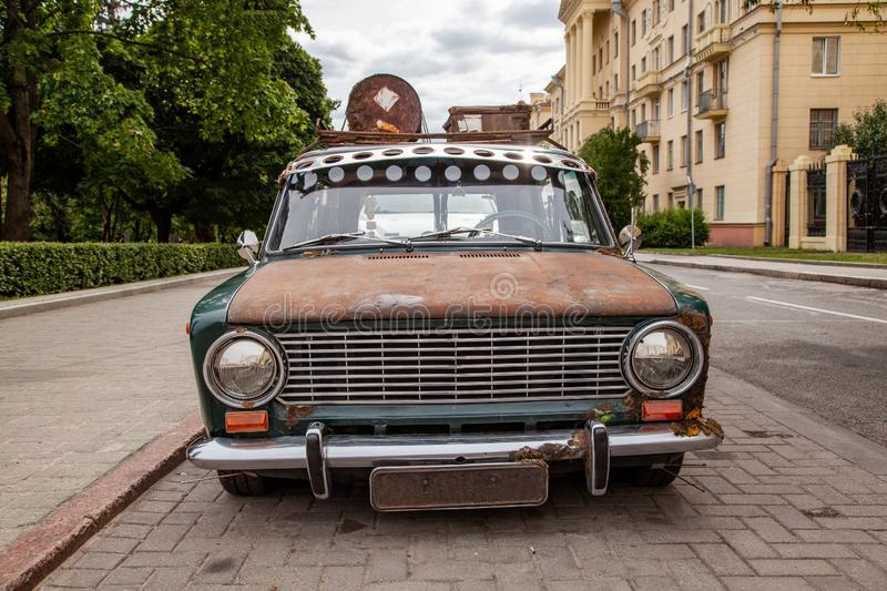 Old car with a roof rack in the city stock photography